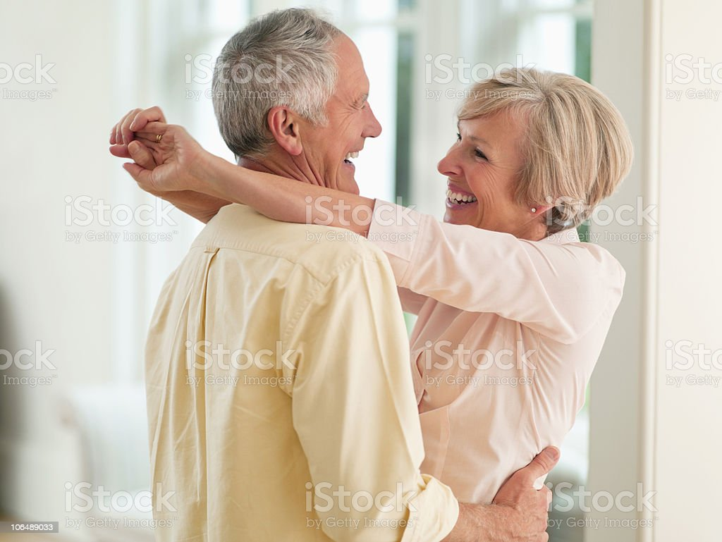 Couple hugging each other, smiling royalty-free stock photo