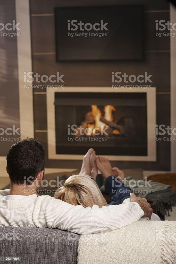 Couple hugging home stock photo