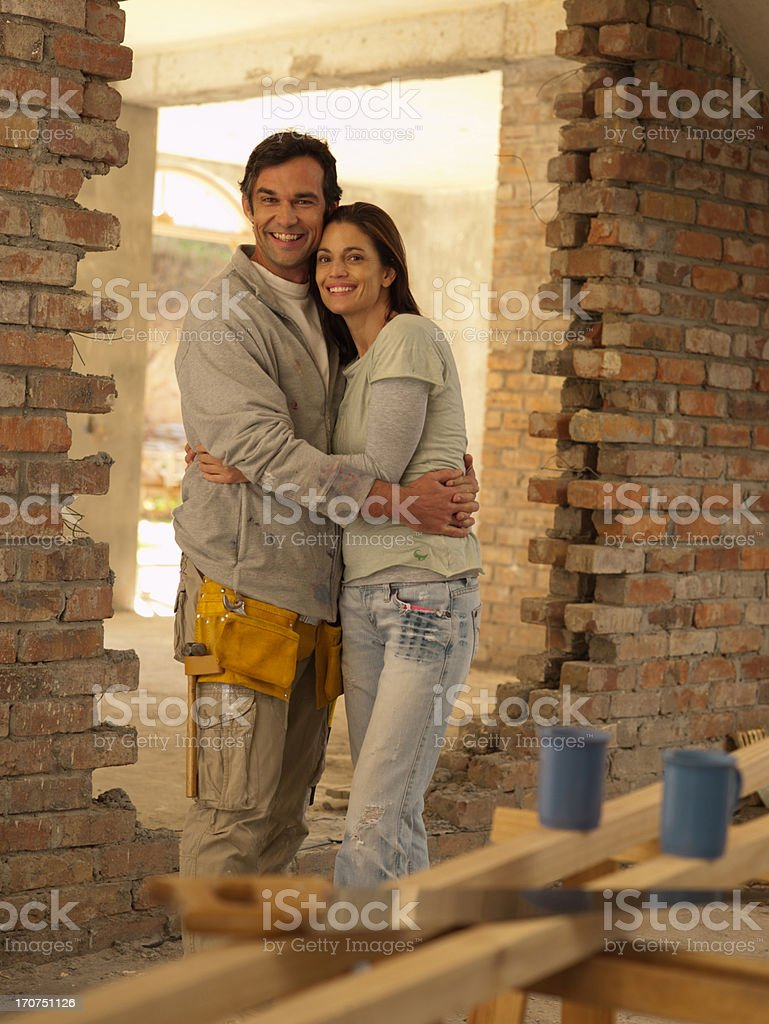 Couple hugging in doorway of house under construction royalty-free stock photo