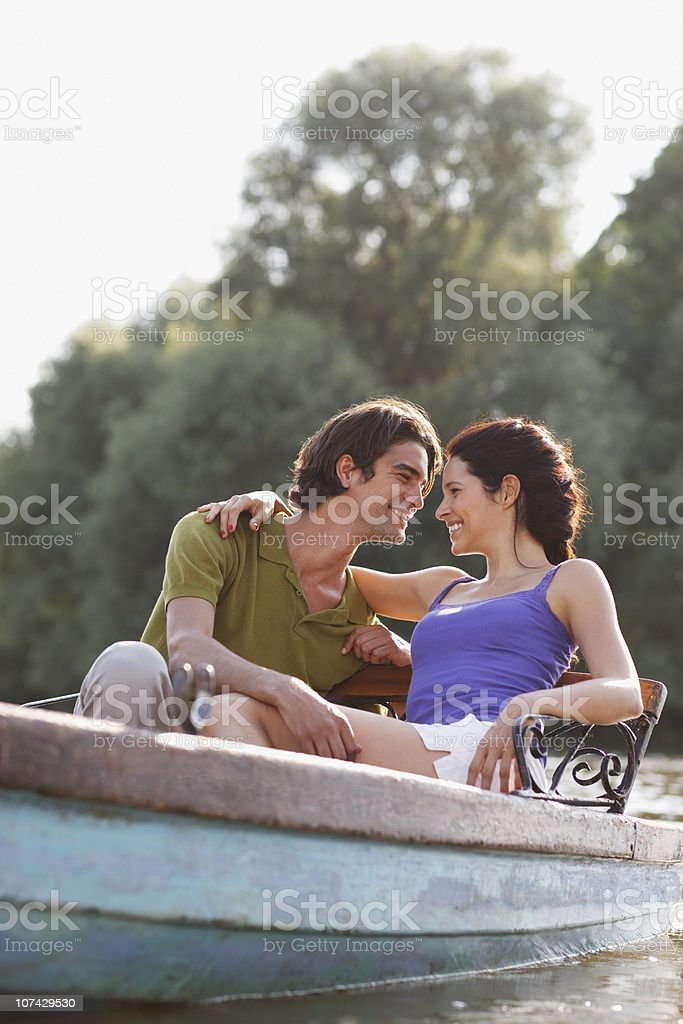 Couple hugging in rowboat on lake royalty-free stock photo