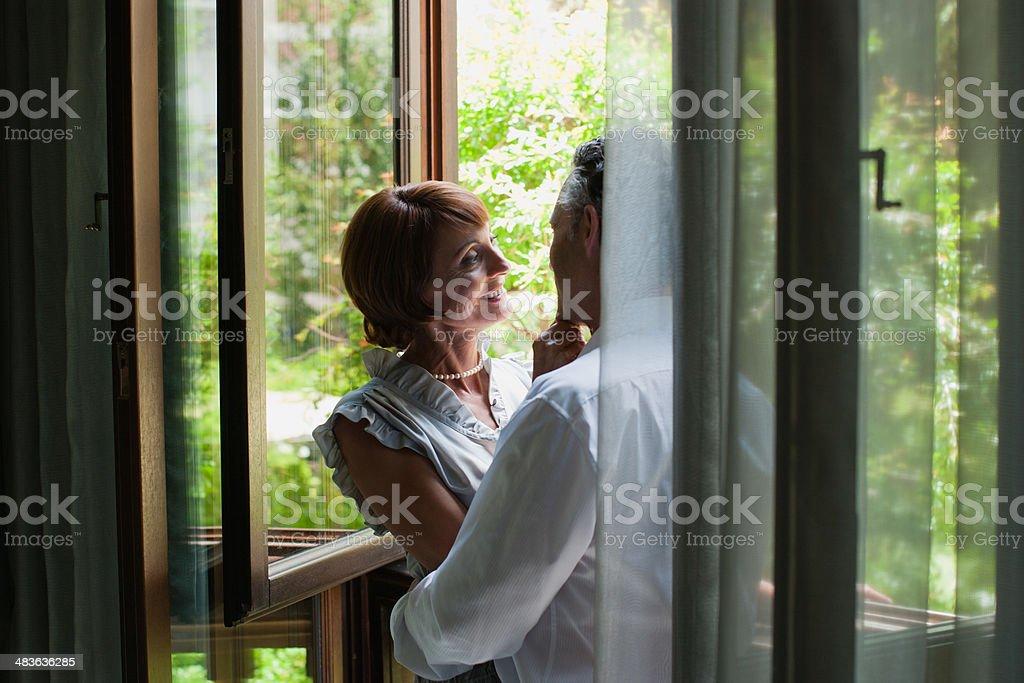 Couple hugging on balcony stock photo