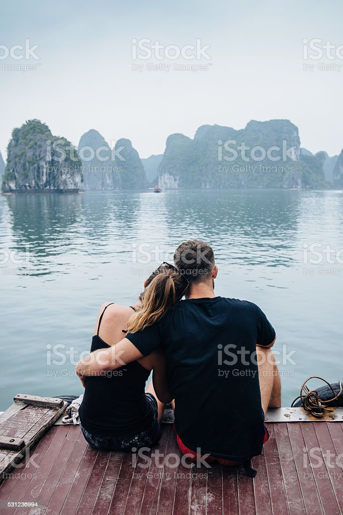 Couple hugging on cruise ship, view on Halong Bay stock photo