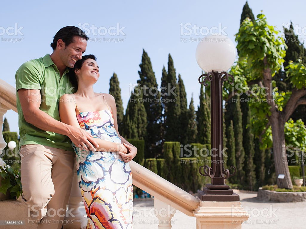 Couple hugging on outdoor staircase stock photo