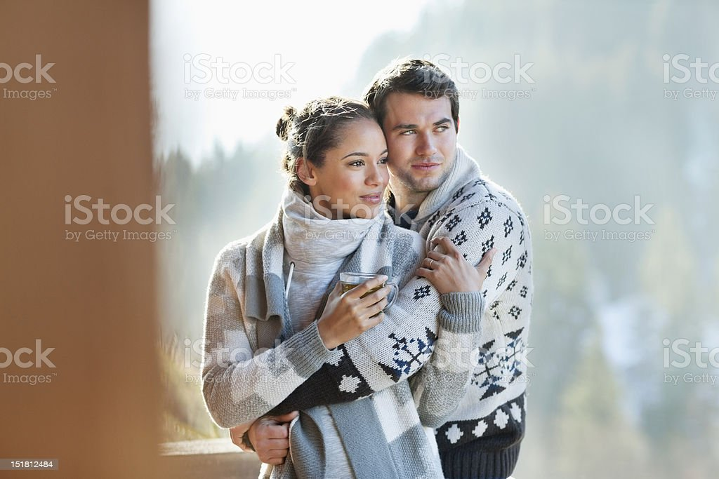 Couple hugging on patio royalty-free stock photo