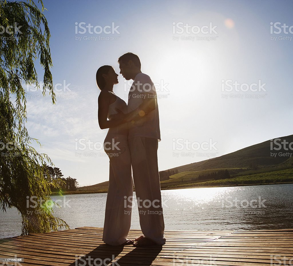 Couple hugging on pier royalty-free stock photo
