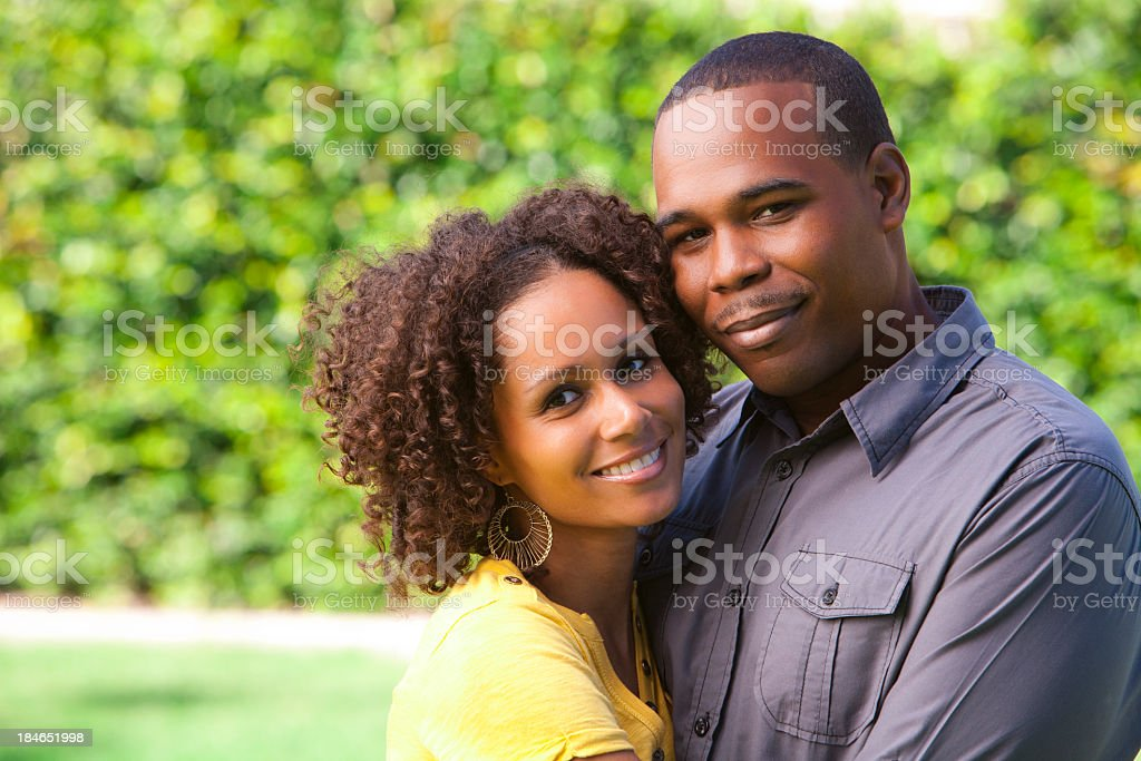 Couple hugging together and smiling royalty-free stock photo