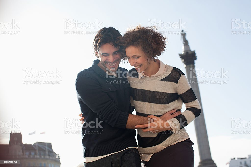 Couple hugging under monument in London royalty-free stock photo