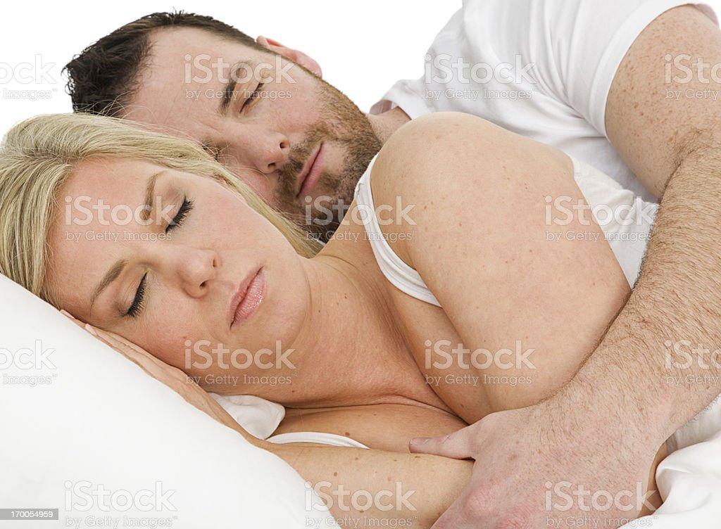 Couple Husband and Wife sound asleep together in bed royalty-free stock photo