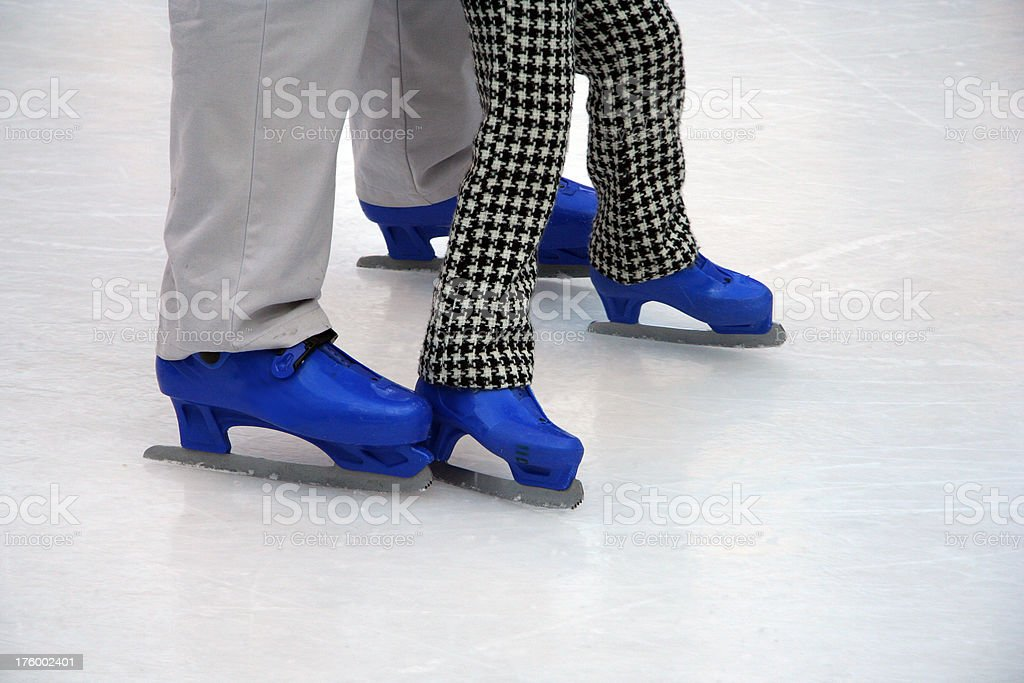 Couple ice skating royalty-free stock photo