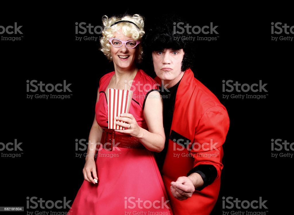 Couple in 1950's style clothes dancing rock and roll stock photo