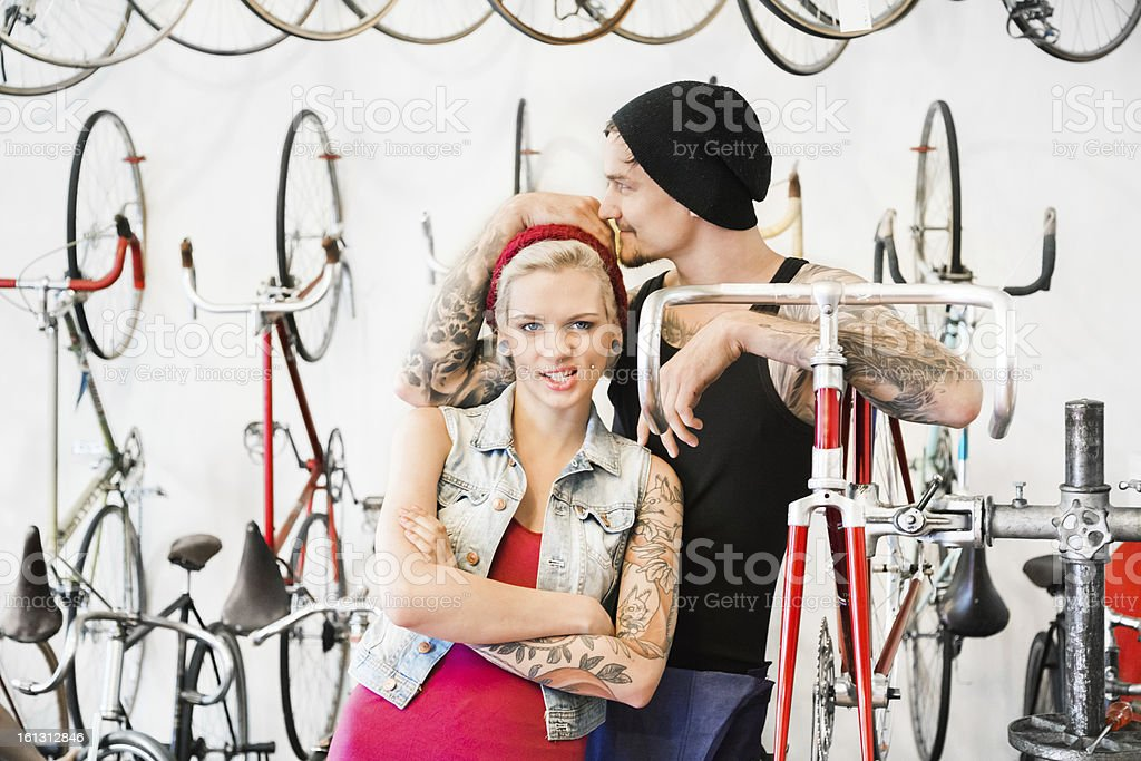 Couple in a Bike Store royalty-free stock photo
