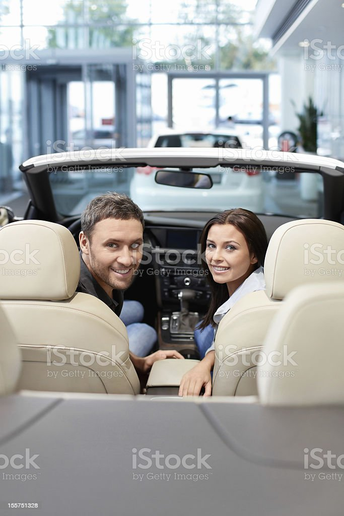 Couple in a cabriolet royalty-free stock photo