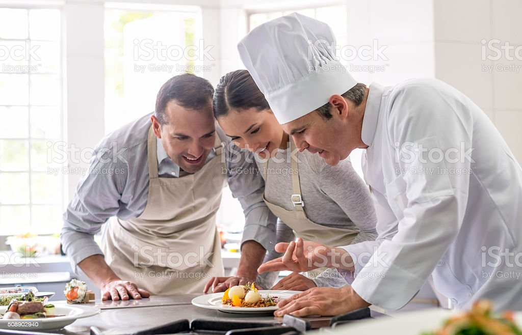 Couple in a cooking class stock photo