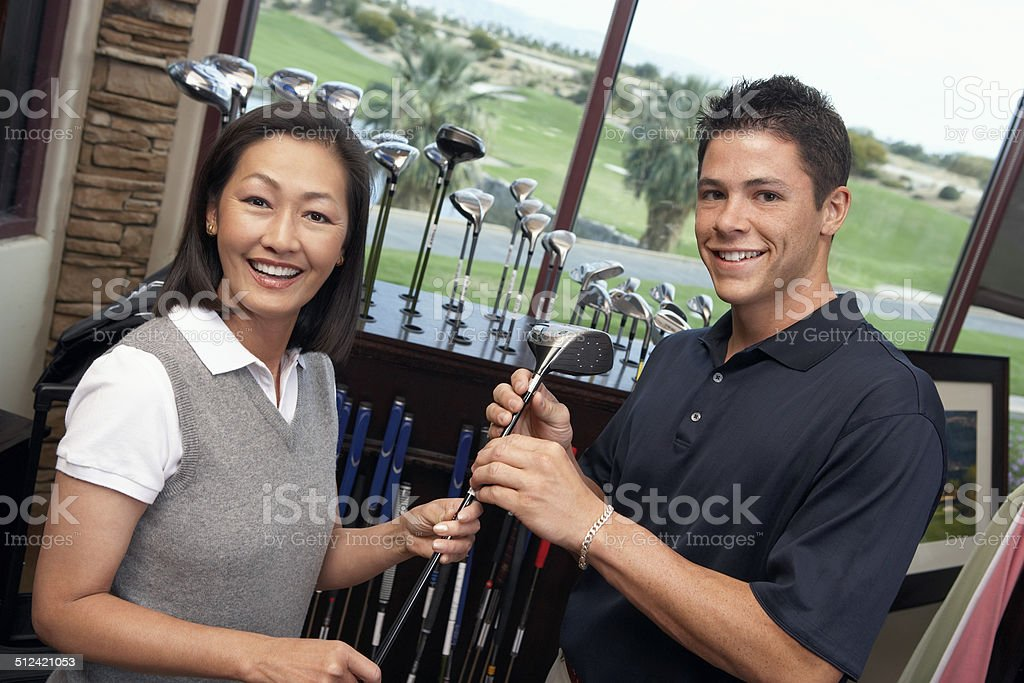 Couple in a Golf Shop stock photo