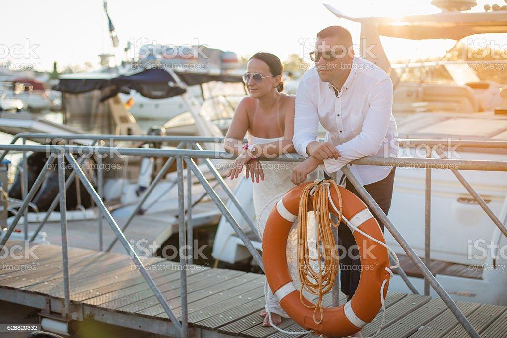 Couple in a harbor enjoying vacation stock photo