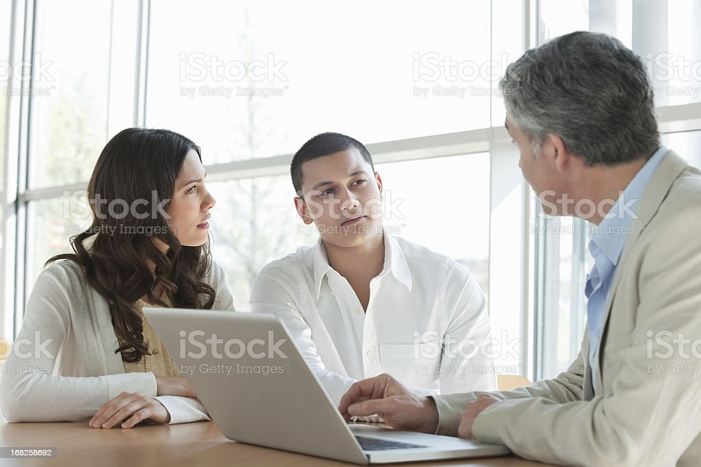 Couple In a Meeting With Financial Advisor royalty-free stock photo