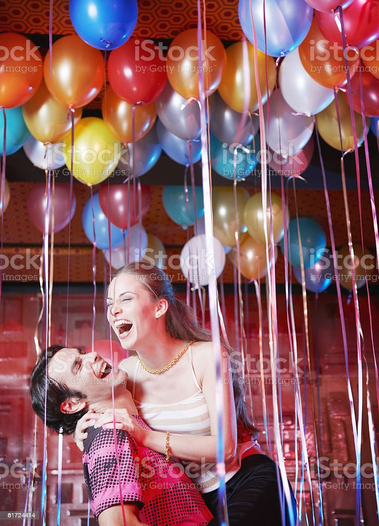 Couple in a nightclub having fun and laughing stock photo