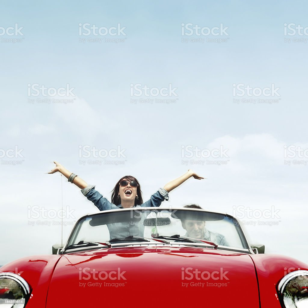 Couple in a red convertible stock photo