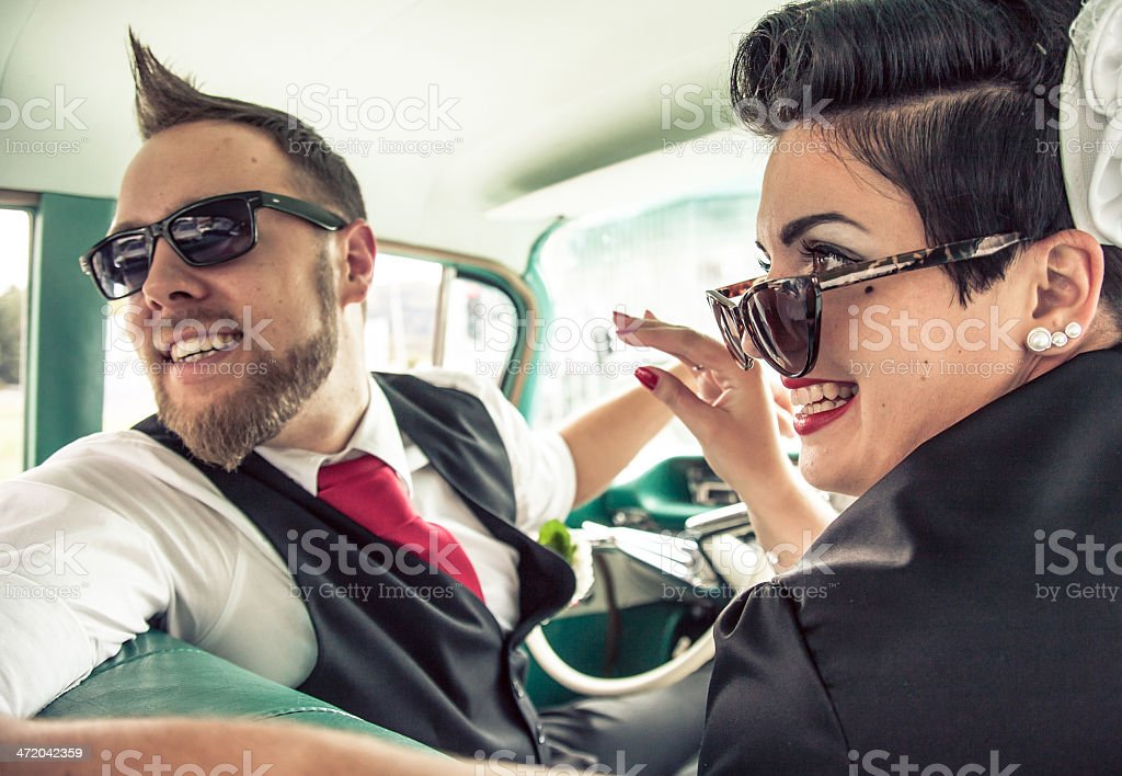 Couple in a retro car on the road stock photo