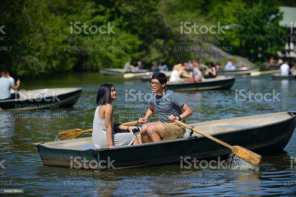 Couple in a rowboat in Central Park New York City stock photo