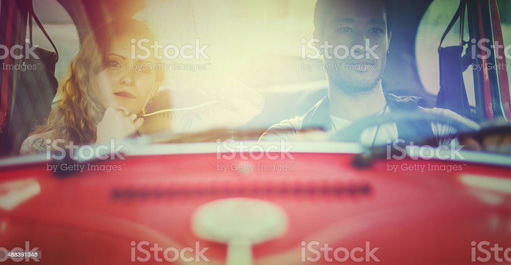 Couple in a vintage car stock photo