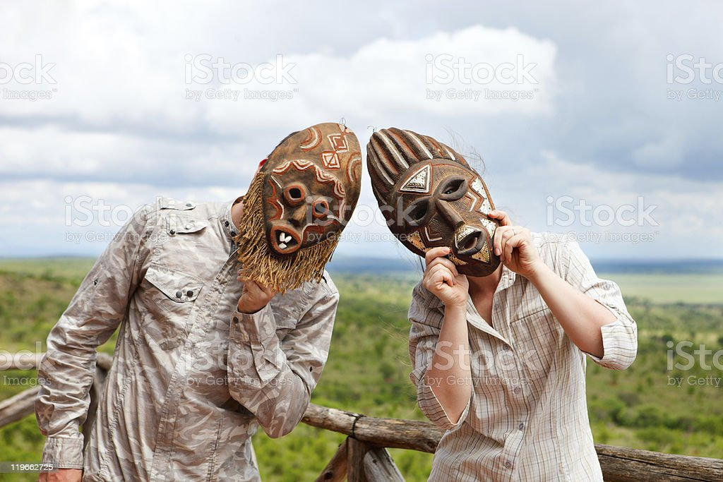 Couple in African masks stock photo