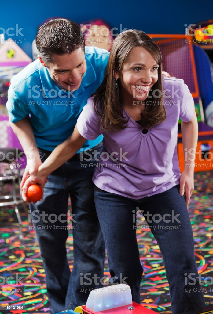 Couple in an Amusement Arcade stock photo