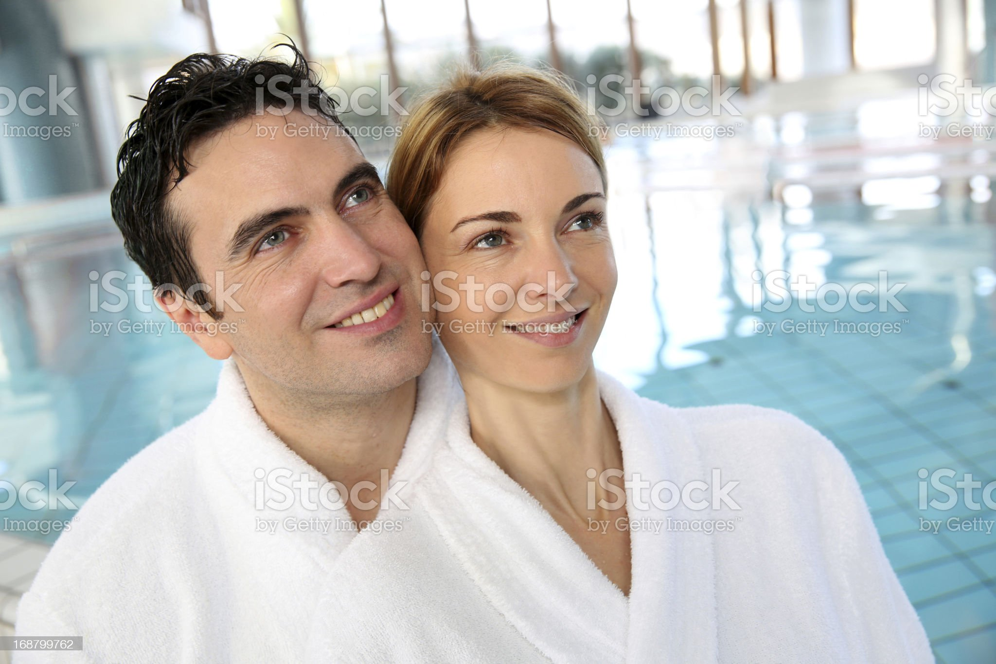 Couple in bathrobe standing at spa center royalty-free stock photo