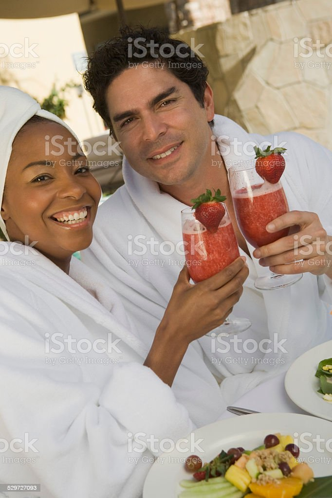 Couple in bathrobes at health spa stock photo