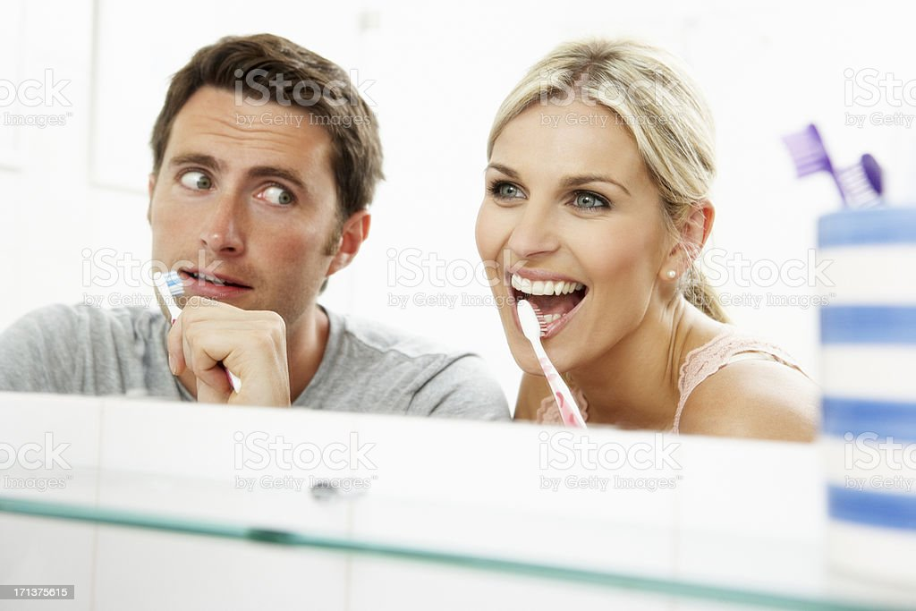 Couple In Bathroom Brushing Teeth royalty-free stock photo
