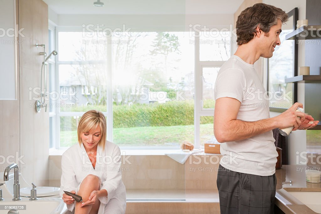 ËCouple in bathroom during morning routine stock photo