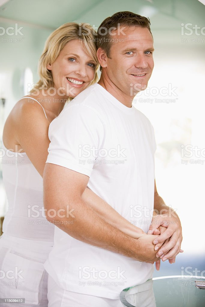 Couple in bathroom embracing royalty-free stock photo