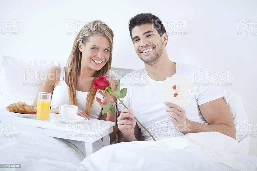 Couple in bed royalty-free stock photo
