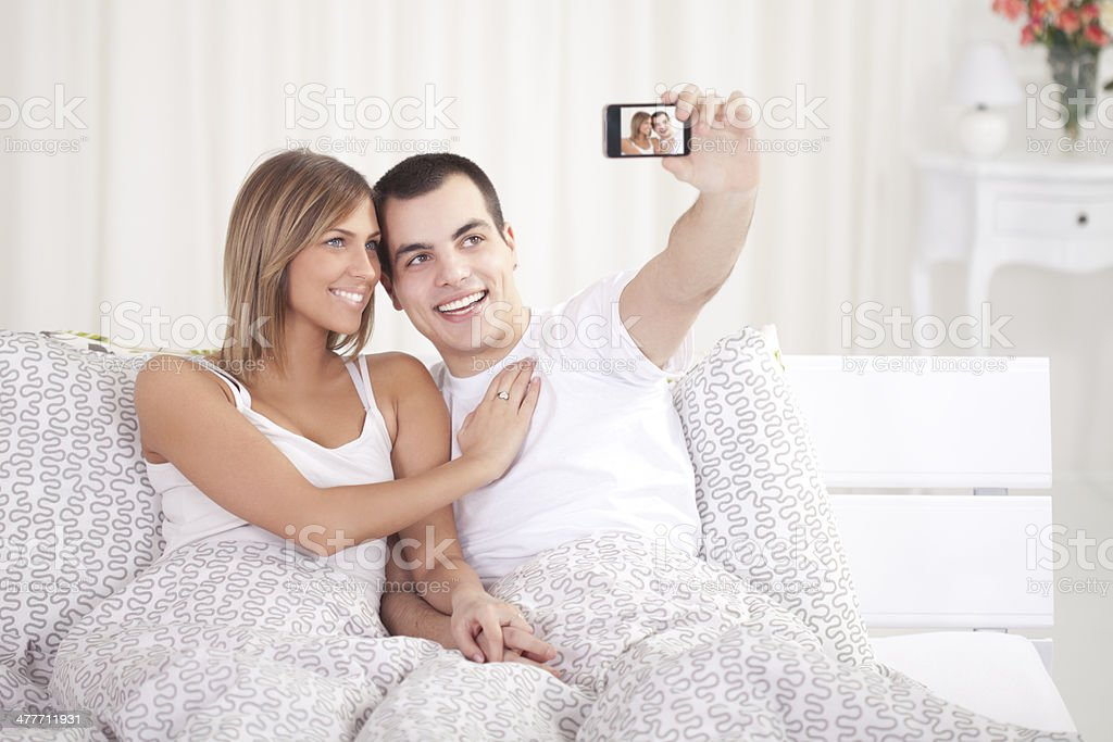 Couple in bed. stock photo