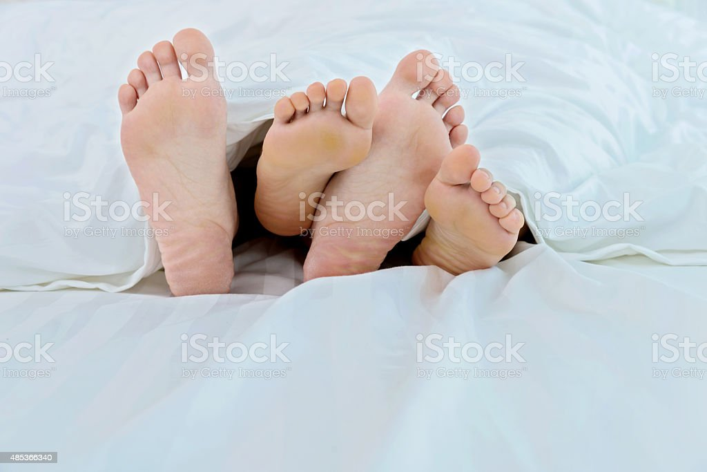Couple in bed stock photo