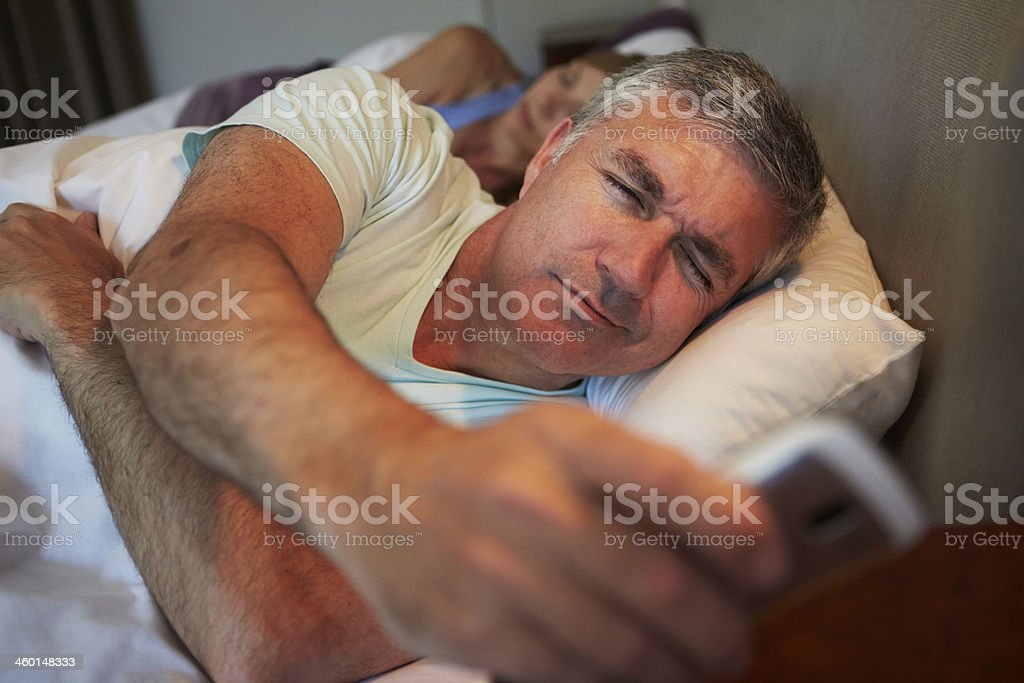 Couple In Bed With Husband Suffering From Insomnia stock photo