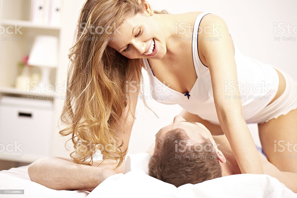 Couple in bedroom royalty-free stock photo