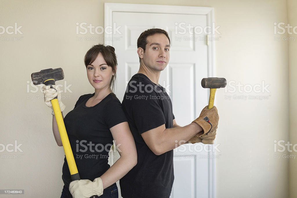 Couple In Black Casuals With Hammers royalty-free stock photo