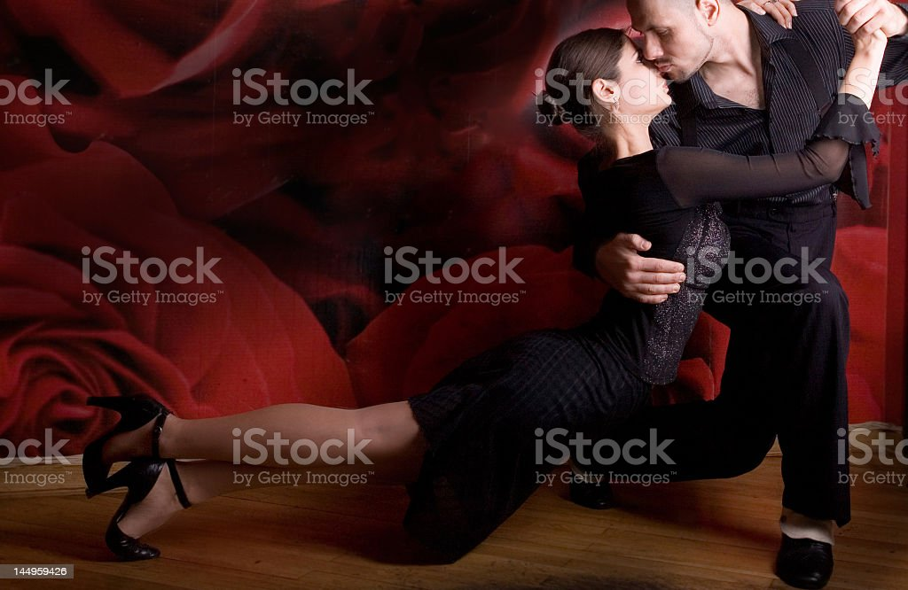 A couple in black having a passionate kiss stock photo