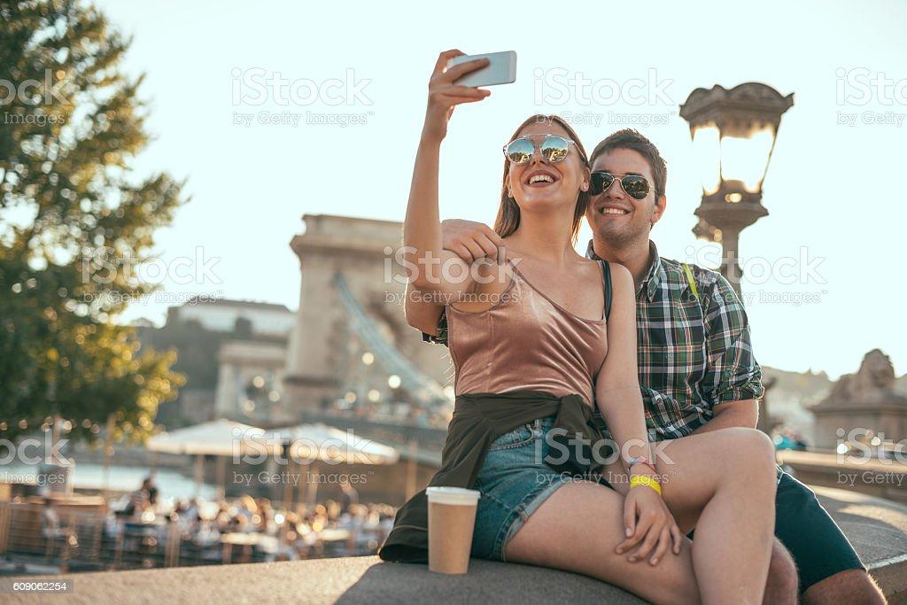 Couple in Budapest, taking selfie near Chain Bridge stock photo