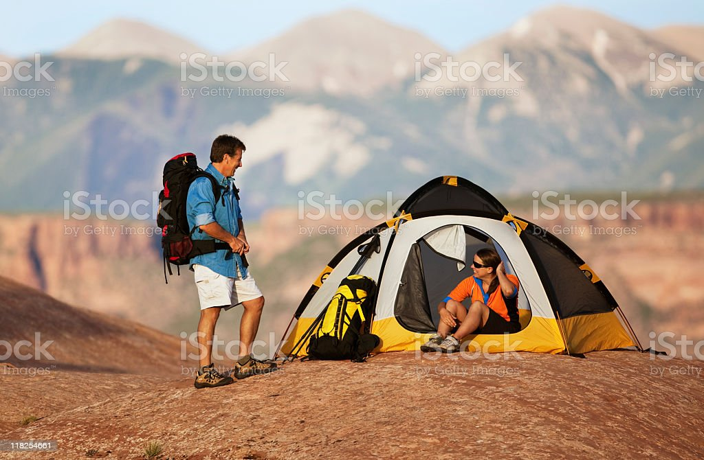 Couple In Campground With Tent And Backpacks royalty-free stock photo