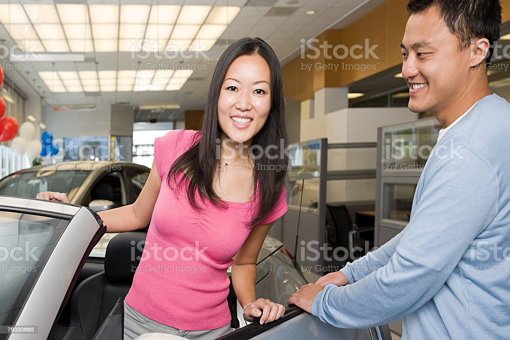 Couple in car showroom royalty-free stock photo