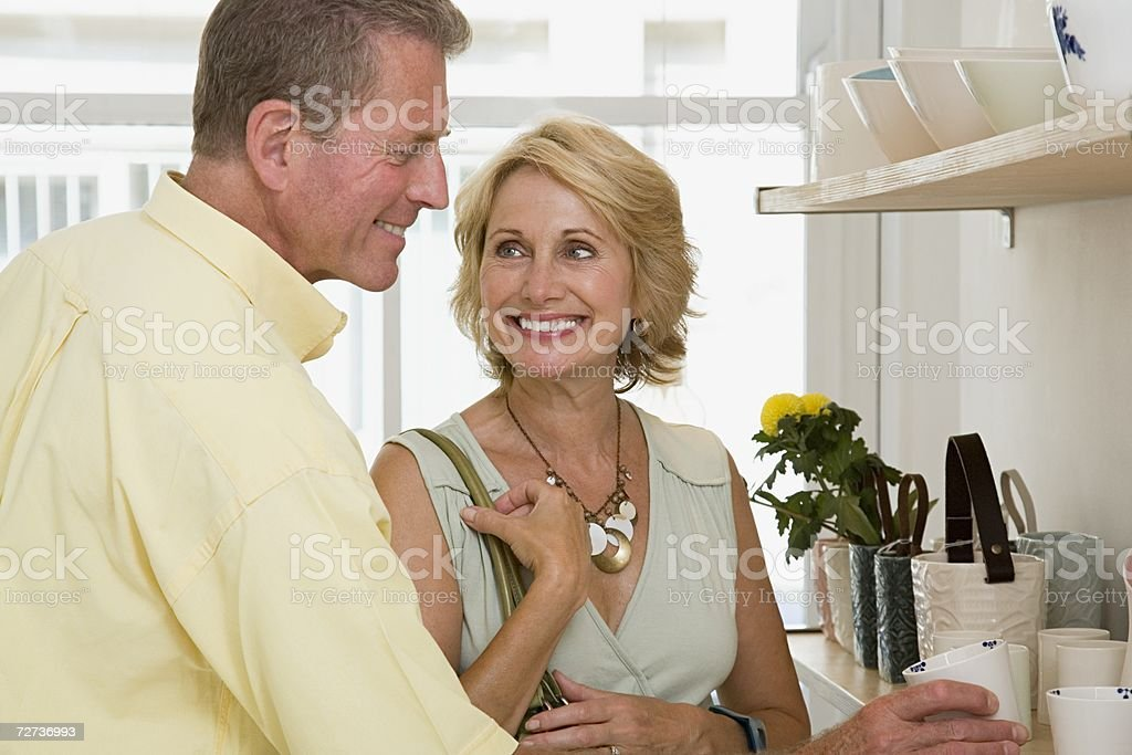 Couple in ceramics shop royalty-free stock photo
