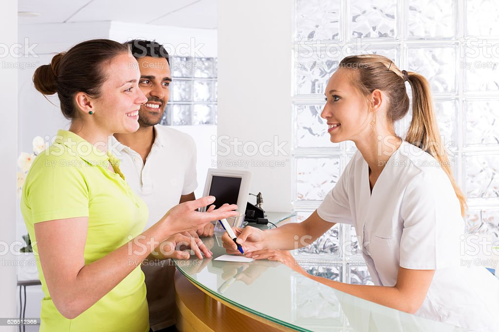 couple in clinic family planning stock photo