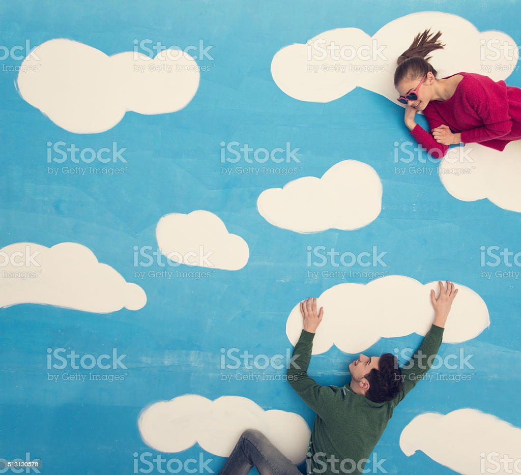Couple in comic book: Flirting on clouds stock photo