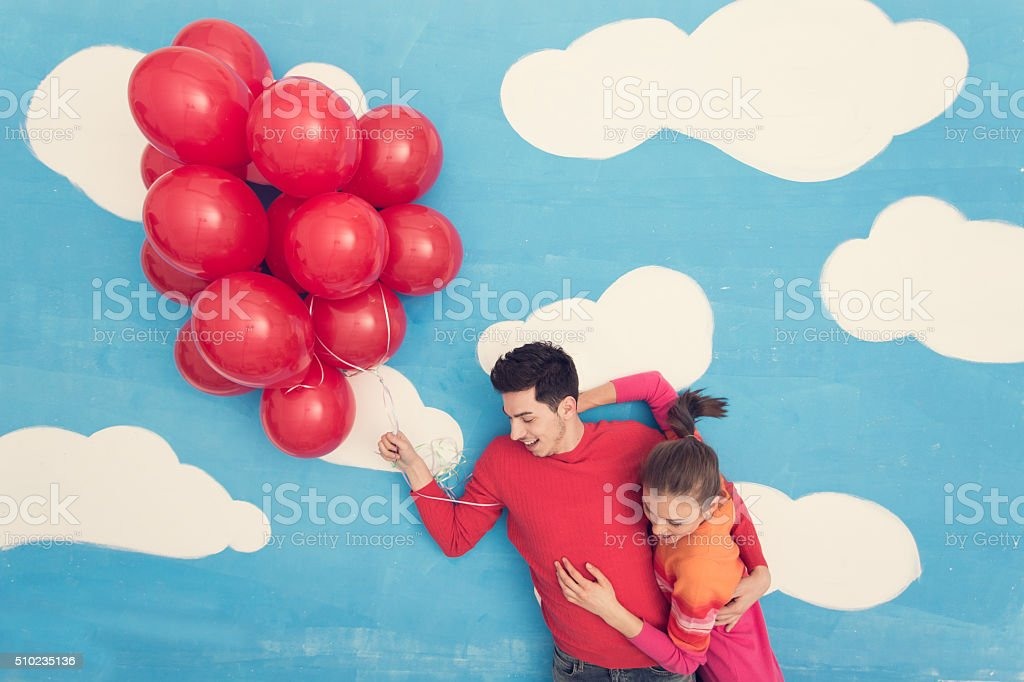 Couple in comic book: flying with balloons stock photo