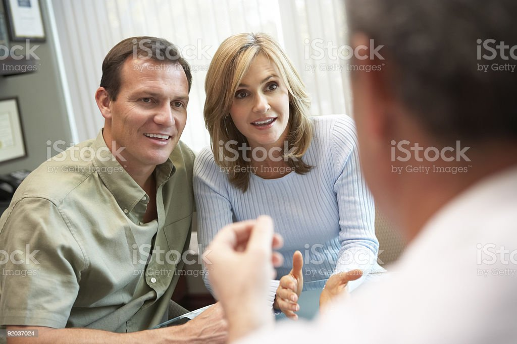 Couple in consultation at IVF clinic stock photo