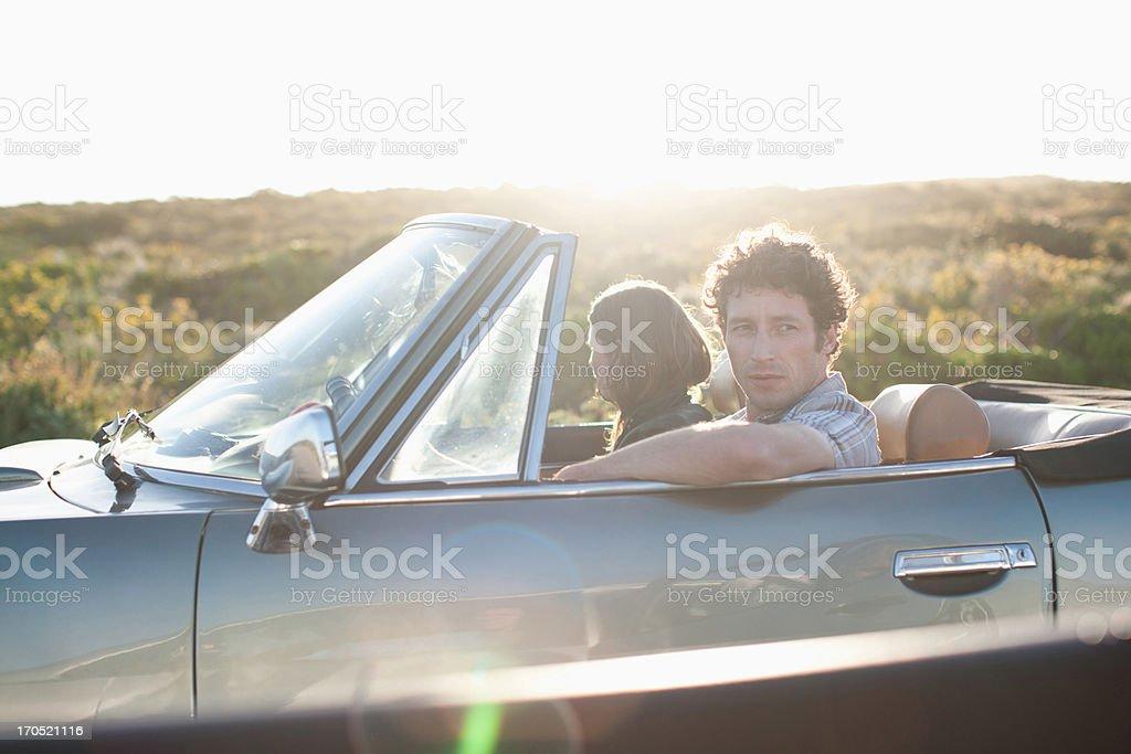 Couple in convertible car stock photo