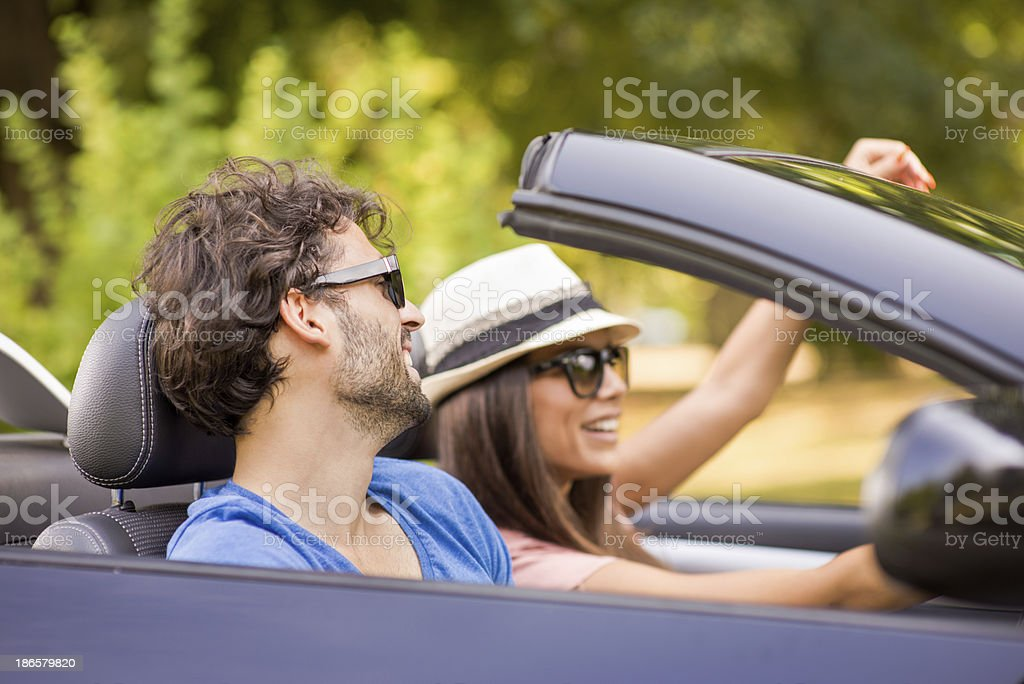 Couple in convertible royalty-free stock photo