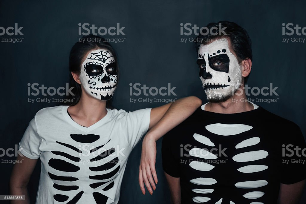 Couple in costume of skeletons stock photo